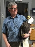 Dr. David Parent with a bald eagle
