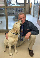 Dr. Benoit and Gooch the yellow lab