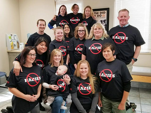 SouthCare Animal Medical Center team in eliminate rabies shirts.
