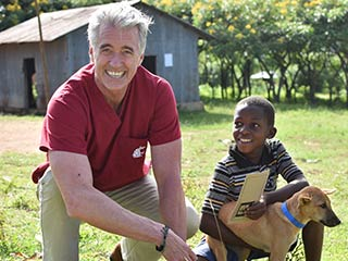 Guy Palmer in Africa helping with rabies vaccinations